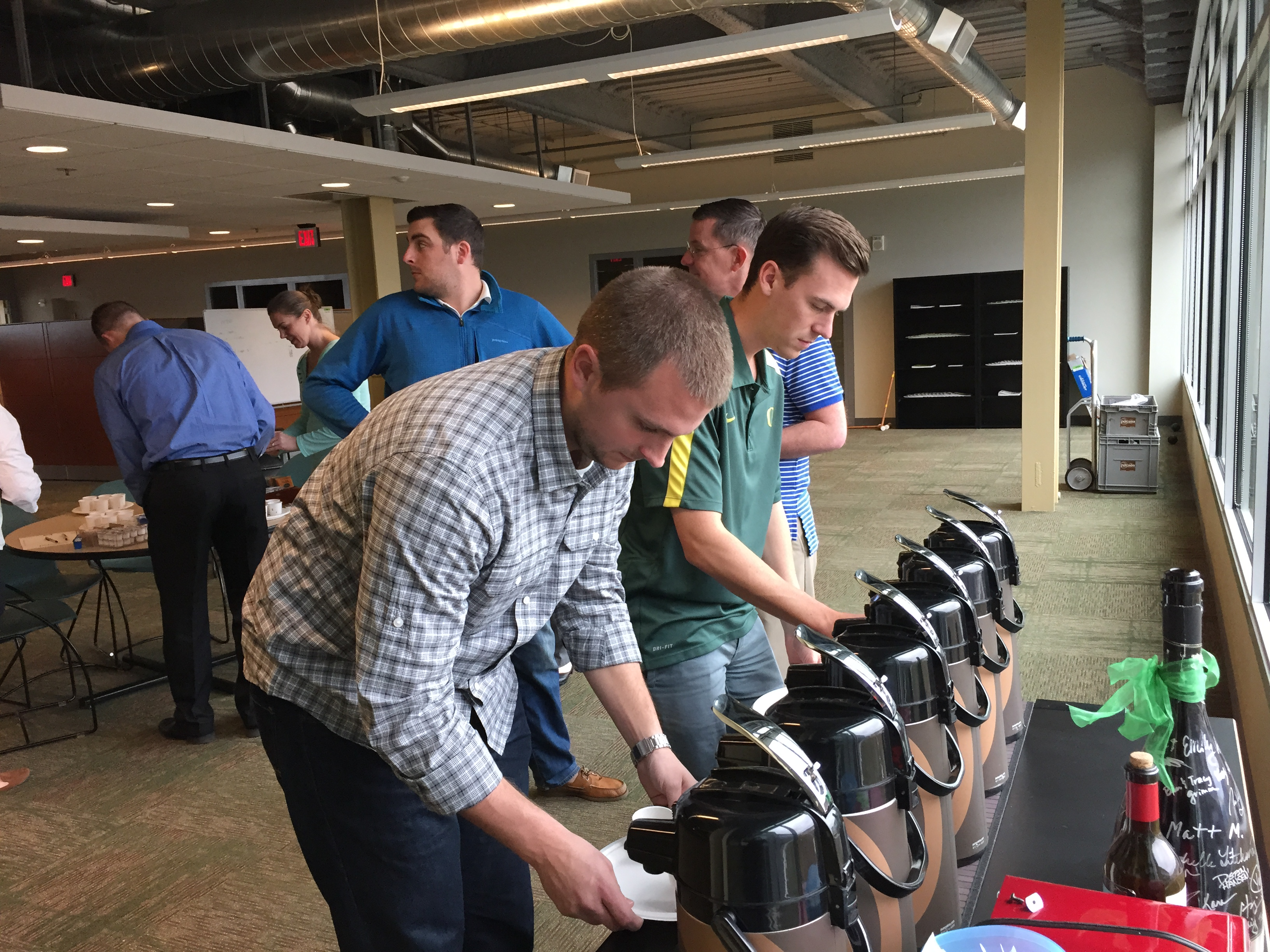 Zapproved employees serving up coffee for the official tasting.