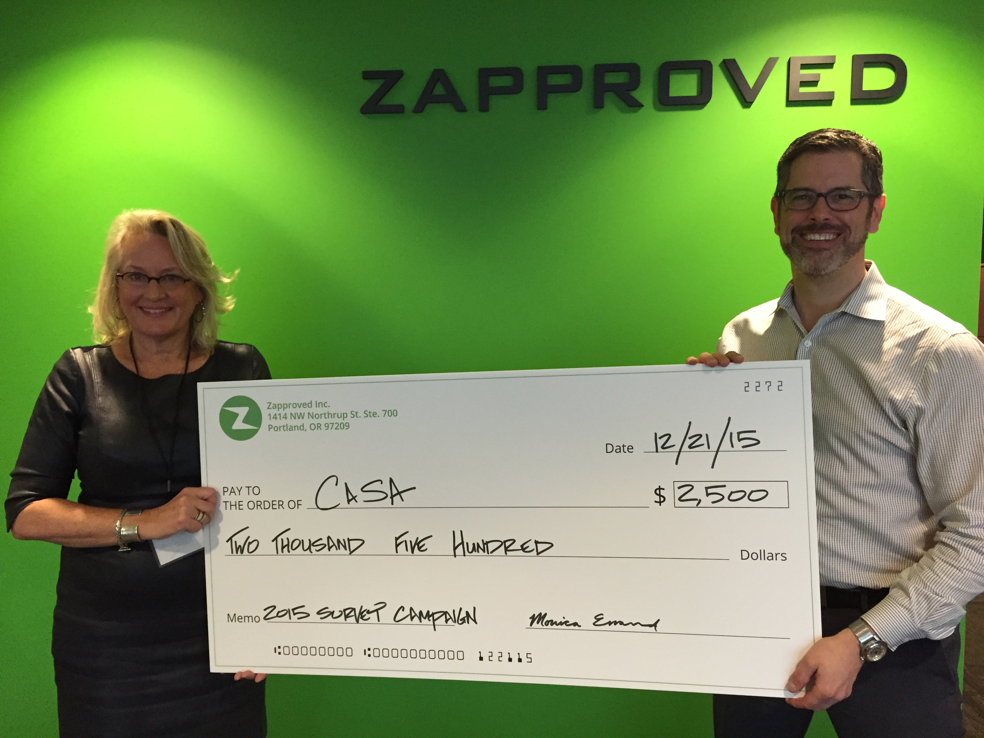 Pictured: Betsy Stark Miller, Executive Director, CASA for Children and Chris Bright, VP of Marketing, Zapproved