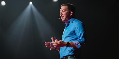 Image of Glenn Greenwald, Pulitzer-Prize winning journalist, who will be featured keynote speaker at PREX17 in Portland, Oregon.