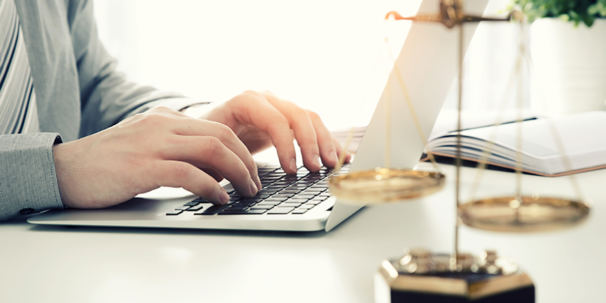Person typing on laptop collecting ESI for legal reasons