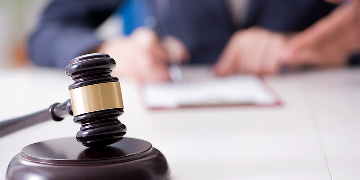 A judge and an unhappy defendant in court over lack of ediscovery process
