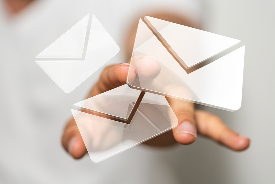 A hand letting go of emails