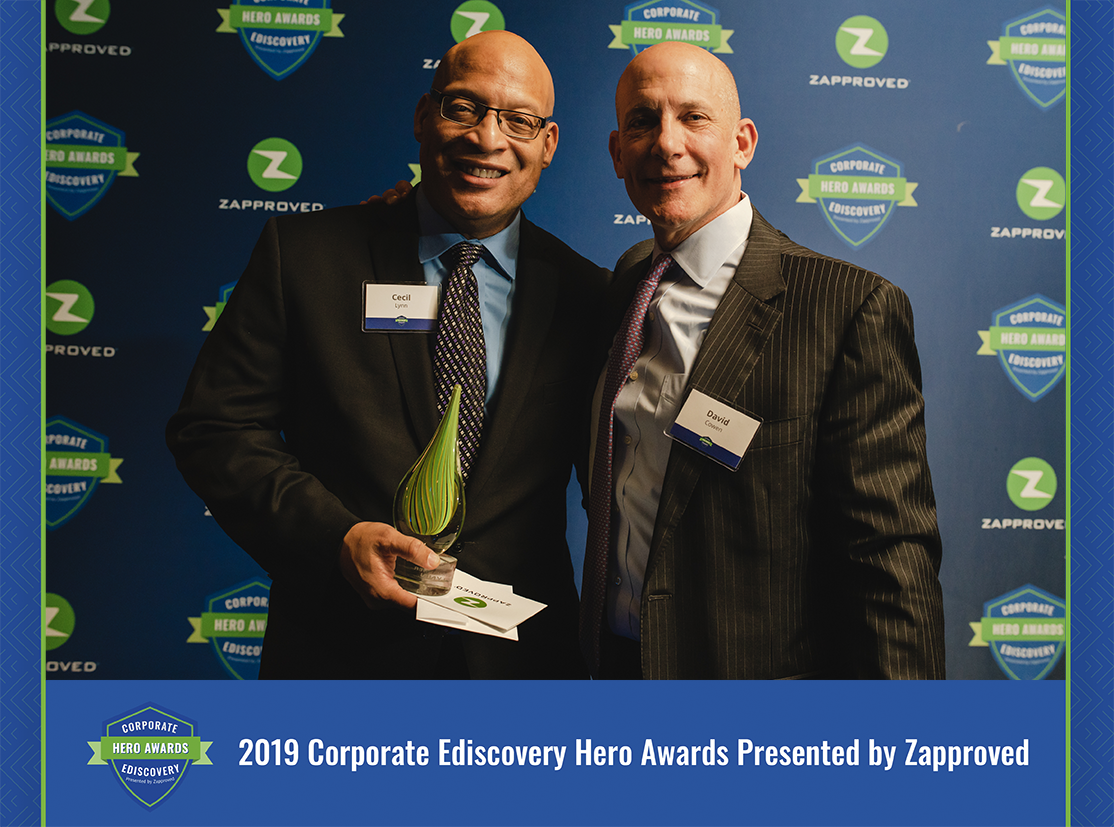 Cecil Lynn accepting a 2019 Corporate Ediscovery Hero Award