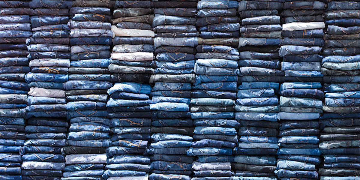 A stack of 100s of jeans folded
