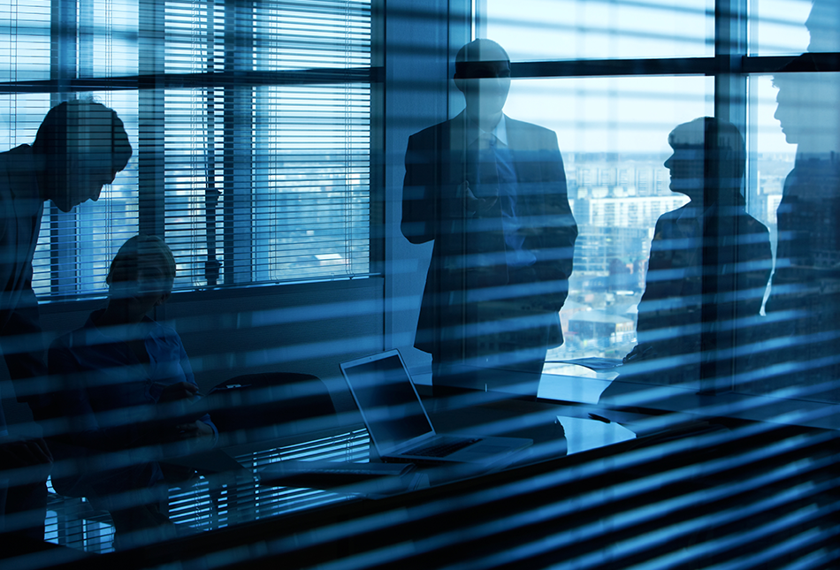 business meeting backlit in a dark office