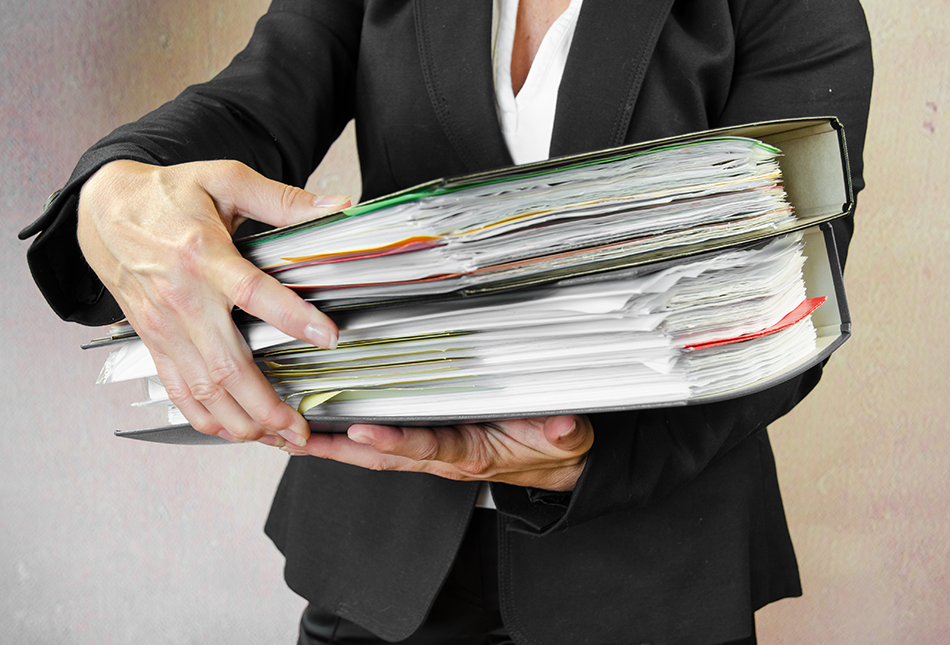 Business woman holding a stack of file folders