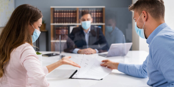 Masked Woman and Man with legal documents