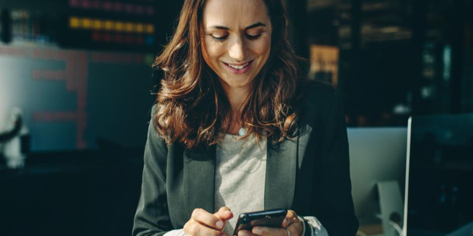 Business woman on mobile device
