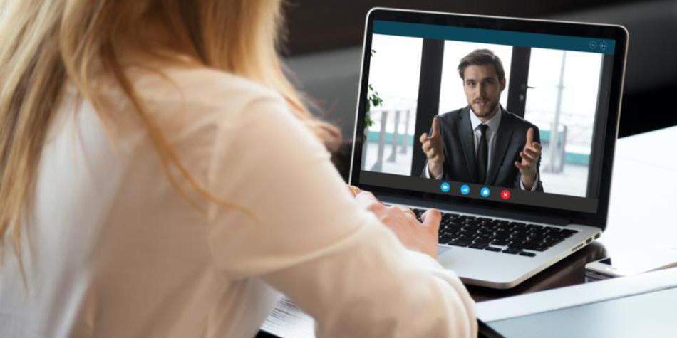 Woman viewing man on laptop