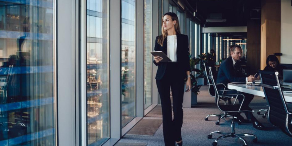 Woman with tablet walking in a conference room