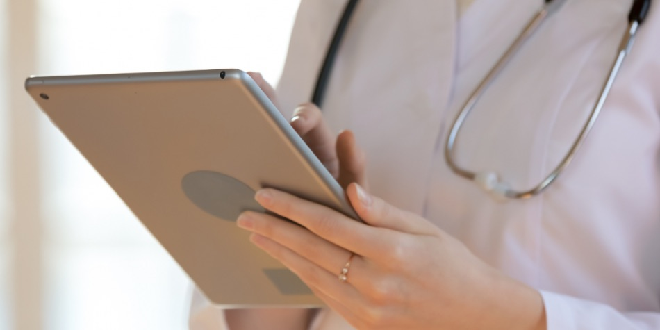 Doctor holding an tablet