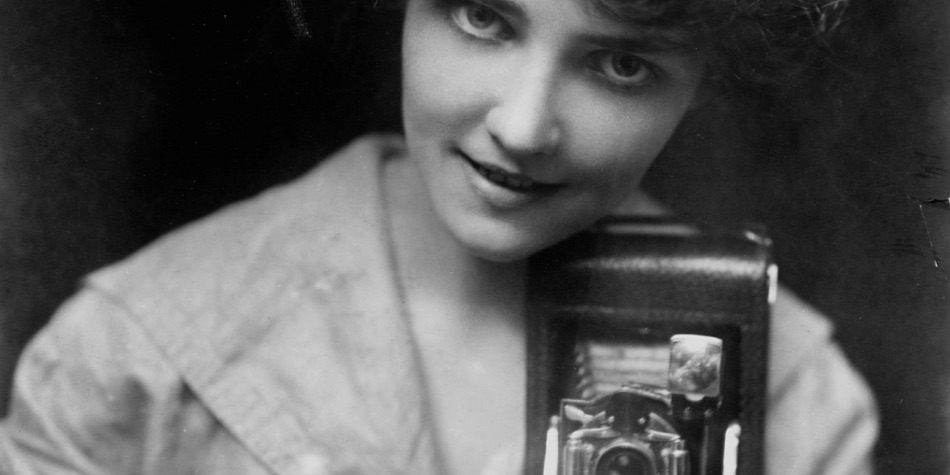 Retro image of woman with a camera